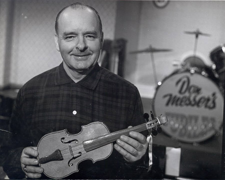 Don Messer holding a fiddle