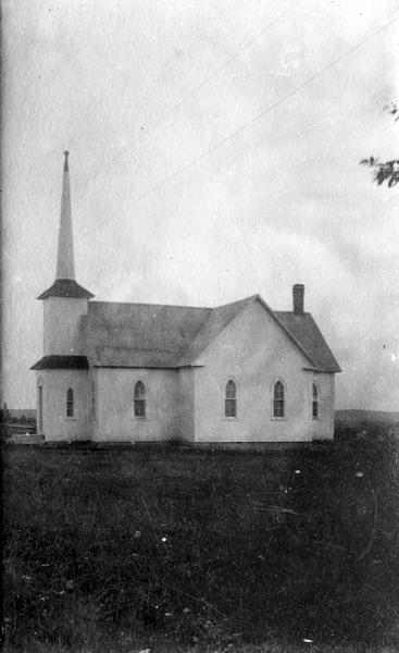 "Postcard of St. Andrews United Church. This structure, originally known as Harvey Presbyterian Church, was built to replace the previous building that was destroyed by fire in 1895. The church became known as Harvey United Church from 1925 following the controversial split between Harvey Presbyterians following the founding of the United Church of Canada. From notes written some years ago by Mary Coburn ""On August 16, 1931, by a congregational vote the name St. Andrew's was given""."