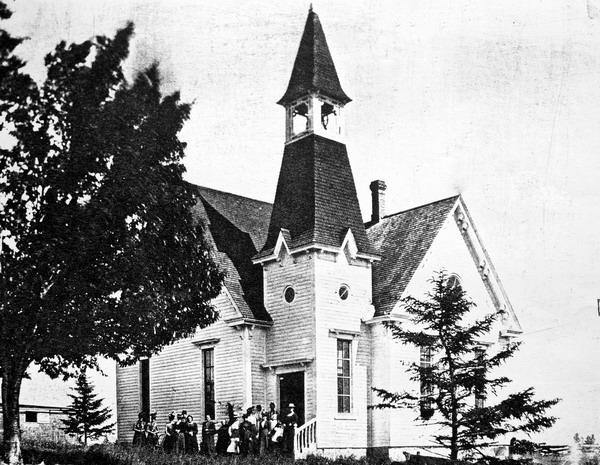 Undated photograph of crowd of ladies in front of St. James Presbyterian Church, Harvey Station, York Co., NB. Image thanks to J.Hall.