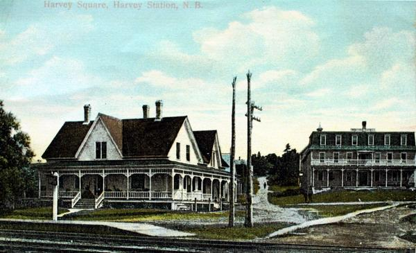 Postcard of Harvey Square, Harvey Station, N.B. View is of Robison Hotel that burned in 1922, and the W.W.E Smith Store , still a landmark in the community. Photographed around 1910. Image thanks to J. Hall.